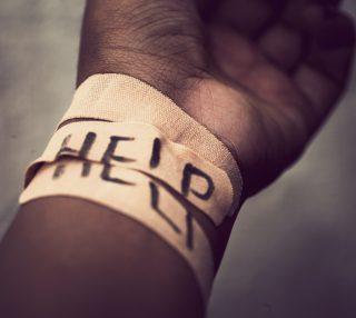 Self-harm wrist covered with bandage
